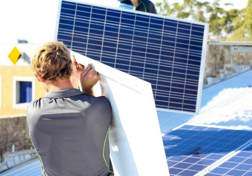 Man carrying solar panel